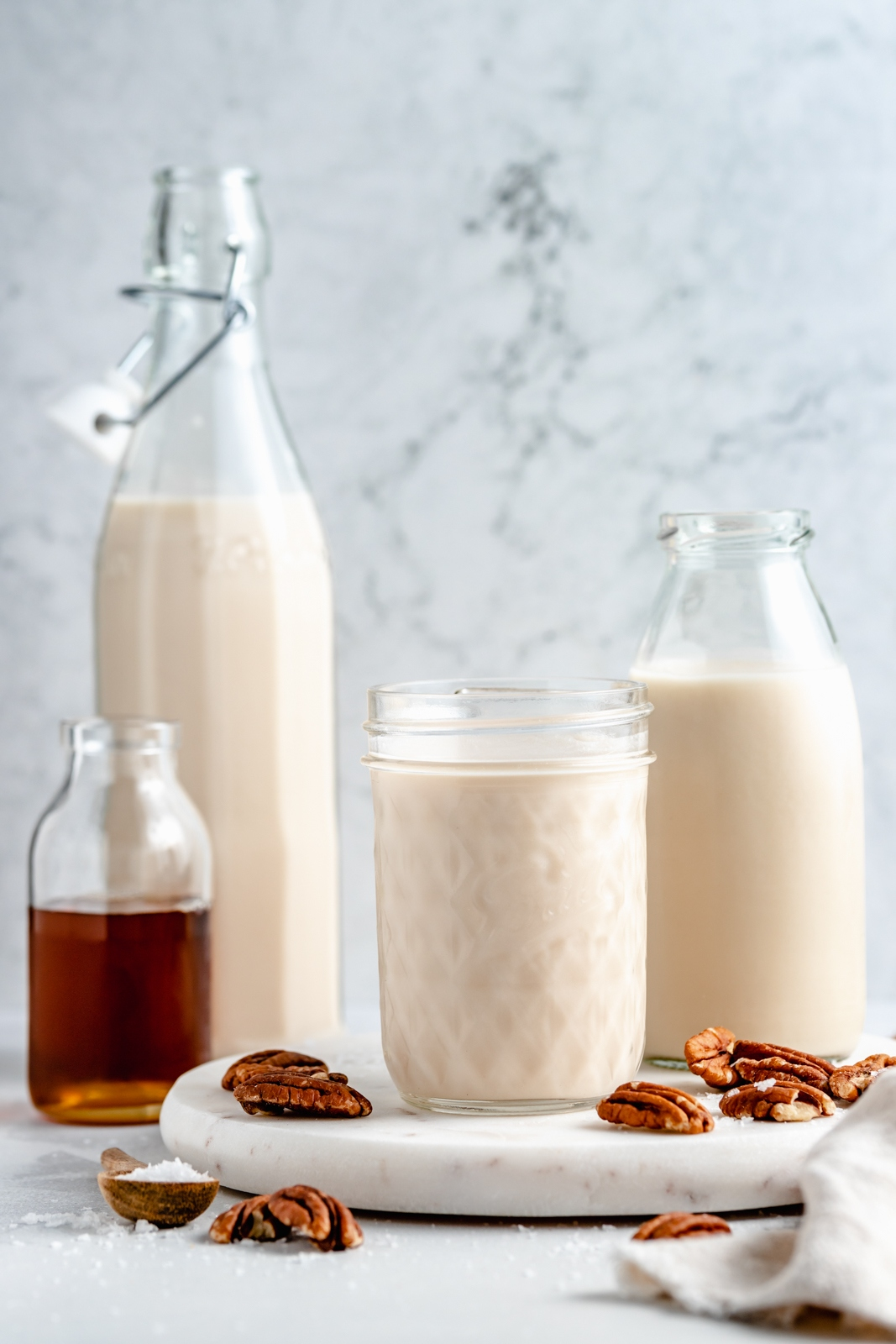 homemade pecan milk in three jars