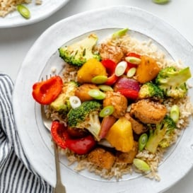 healthy sweet and sour chicken stir fry with broccoli and pineapple on a plate