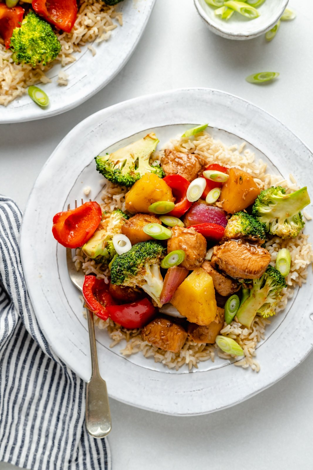 sweet and sour chicken stir fry with pineapple and broccoli on a plate
