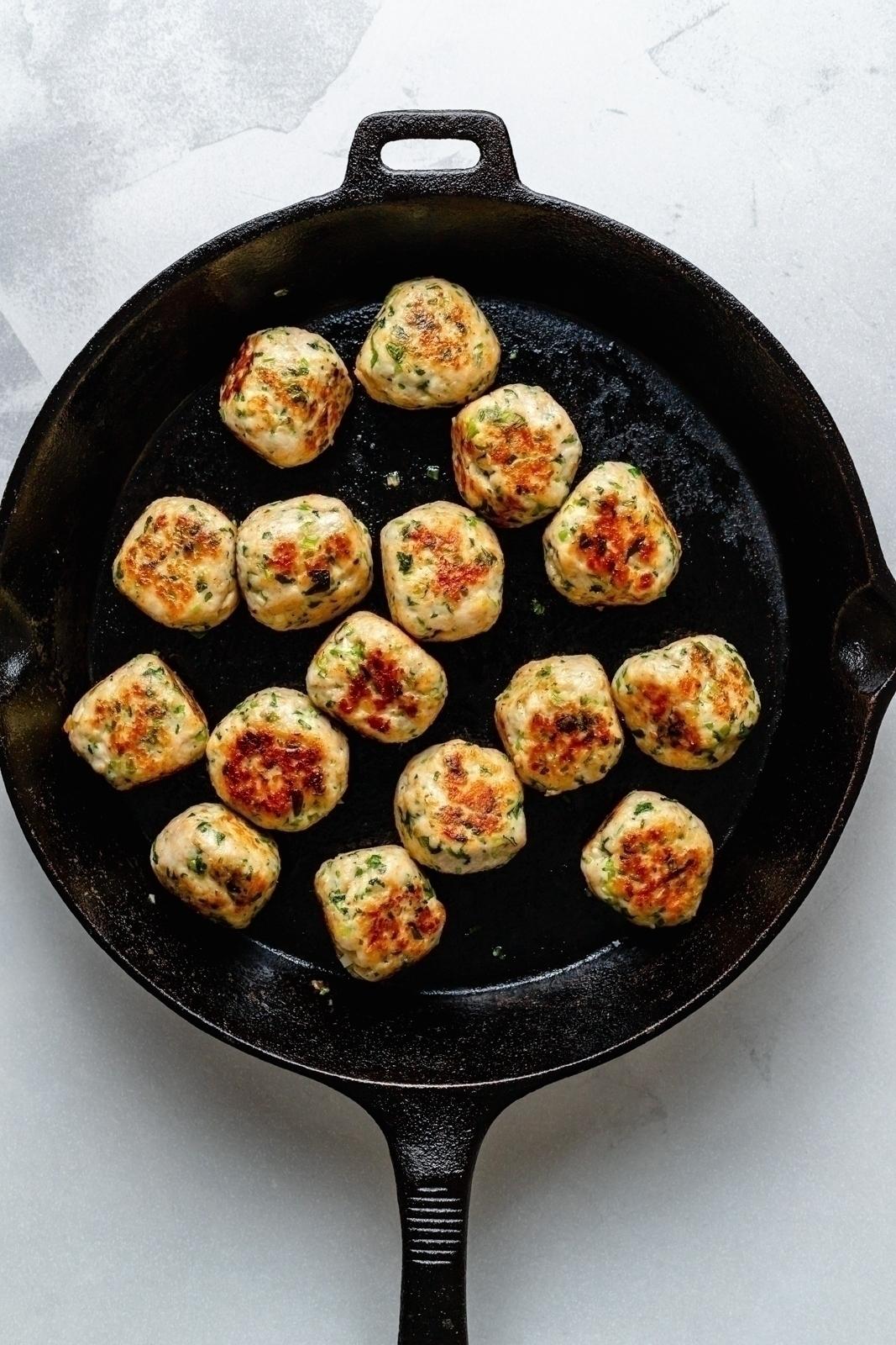 healthy sesame chicken meatballs in a skillet