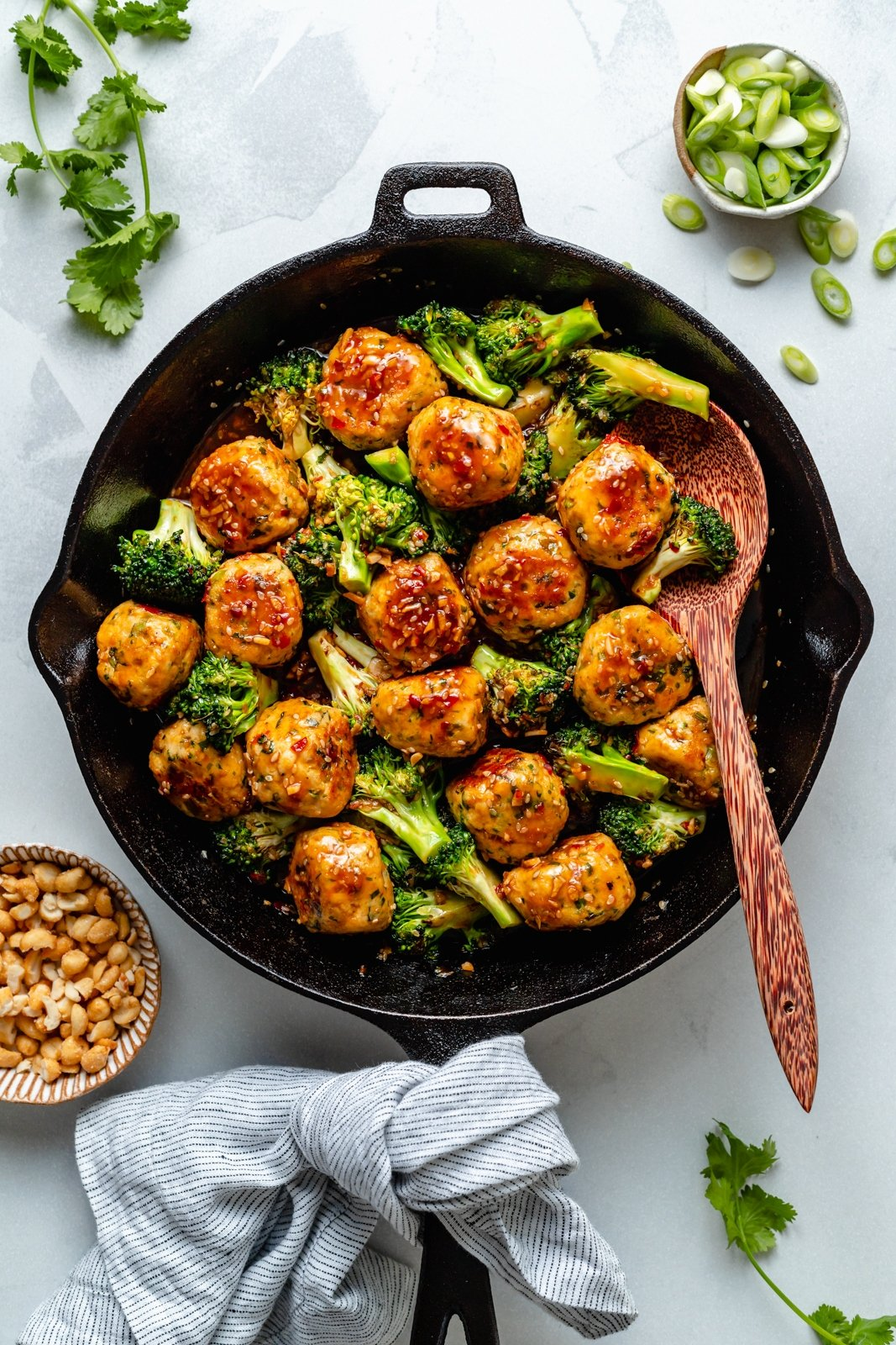 ginger sesame chicken meatballs and broccoli in a skillet