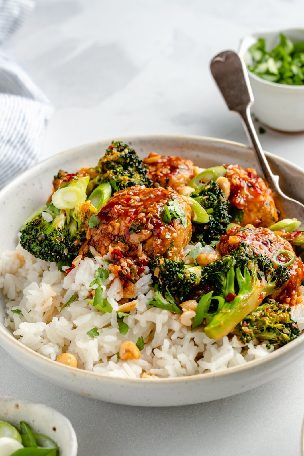 one pan sesame chicken meatballs with broccoli in a bowl with rice