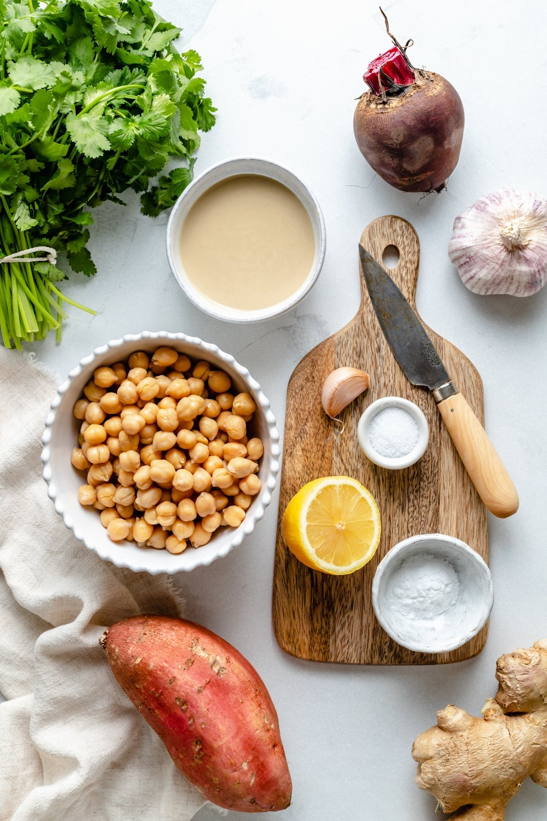 ingredients for homemade hummus on a grey board