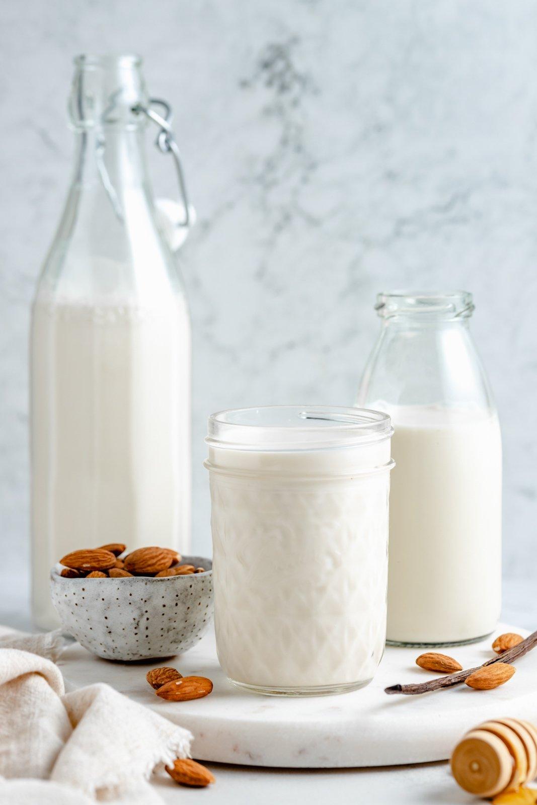 creamy homemade almond milk in three jars