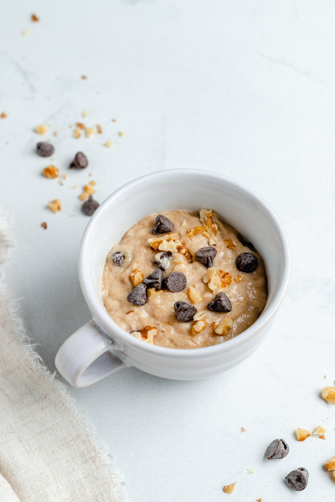 unbaked vegan banana bread mug cake topped with chocolate chips
