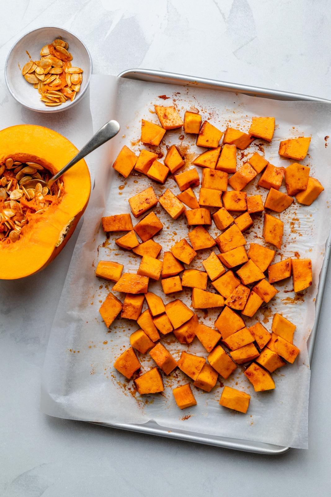 cubed pumpkin on a baking sheet